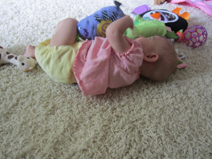 Ginny playing in her comfy cloth diaper