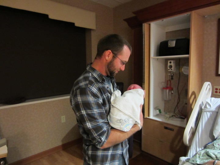 Thomas proudly holding his brand new baby girl, 12/13/12